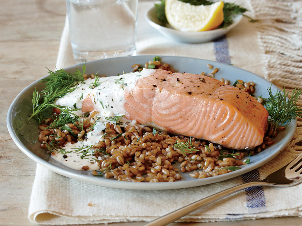 You may find a few salmon options at the counter; go for sustainable farmed Atlantic salmon, U.S. farmed coho, or wild Alaskan salmon. Serve over a bed of prepared farro.