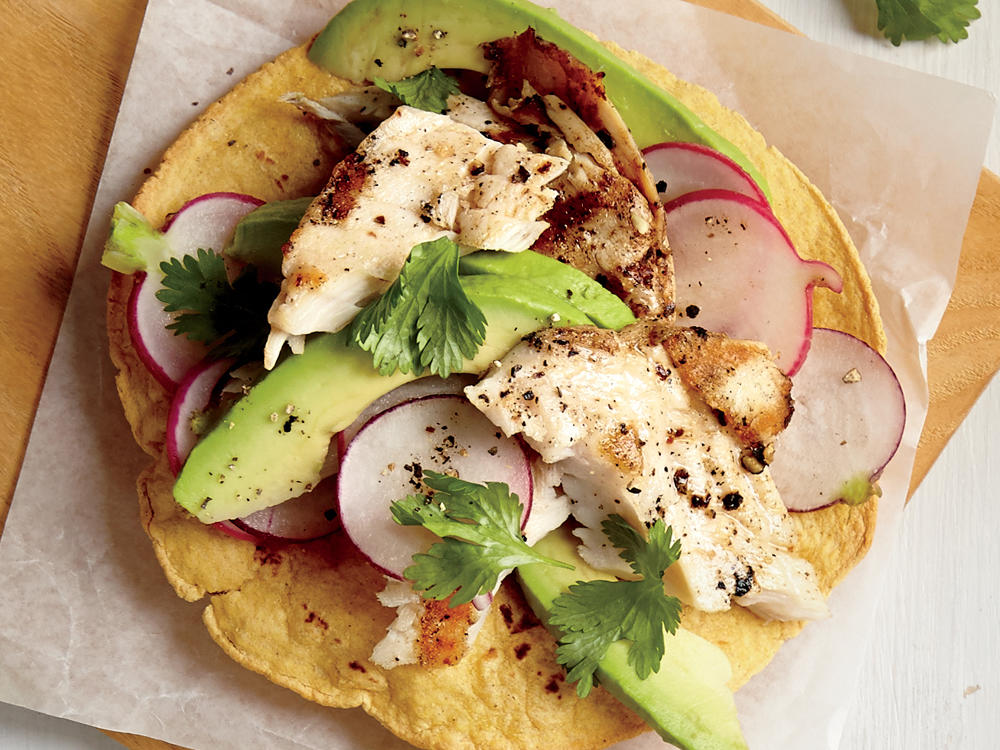 You can make a tostada out of basically any ingredients as long as you start with a crisped tortilla. Creamy avocado sits atop pan-seared tilapia for a fresh and flavorful meal that will leave you wanting two. Go with 6-inch whole-grain corn tortillas instead of flour, and you'll save about 30 calories and 200mg sodium.