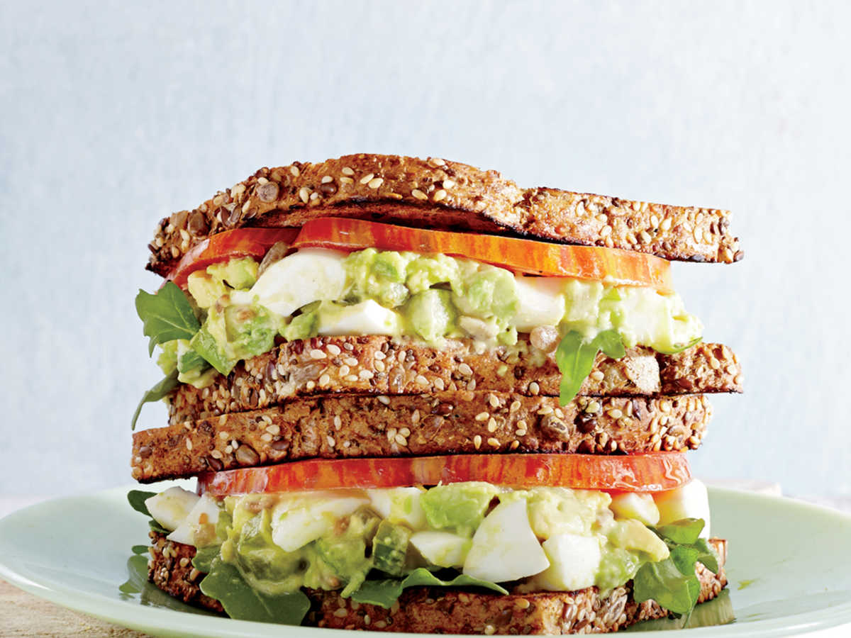 Egg salad is a lunch-time favorite, a go-to because it's quick, easy to prepare, and rich in filling protein. A typical homemade version can load on more than 23g of fat and almost 900mg sodium—suddenly making your so-called light lunch feel anything but. Our avocado trick cuts fat in half, keeping all the creamy goodness of classic egg salad. The crunch of pickled celery add texture and flavor for a well-layered sandwich.