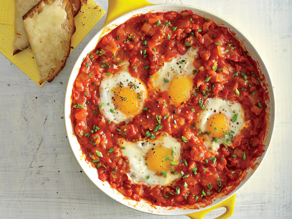 Easy egg recipes for dinner cooking light eggs poached in tomato sauce with garlic cheese toasts forumfinder Choice Image