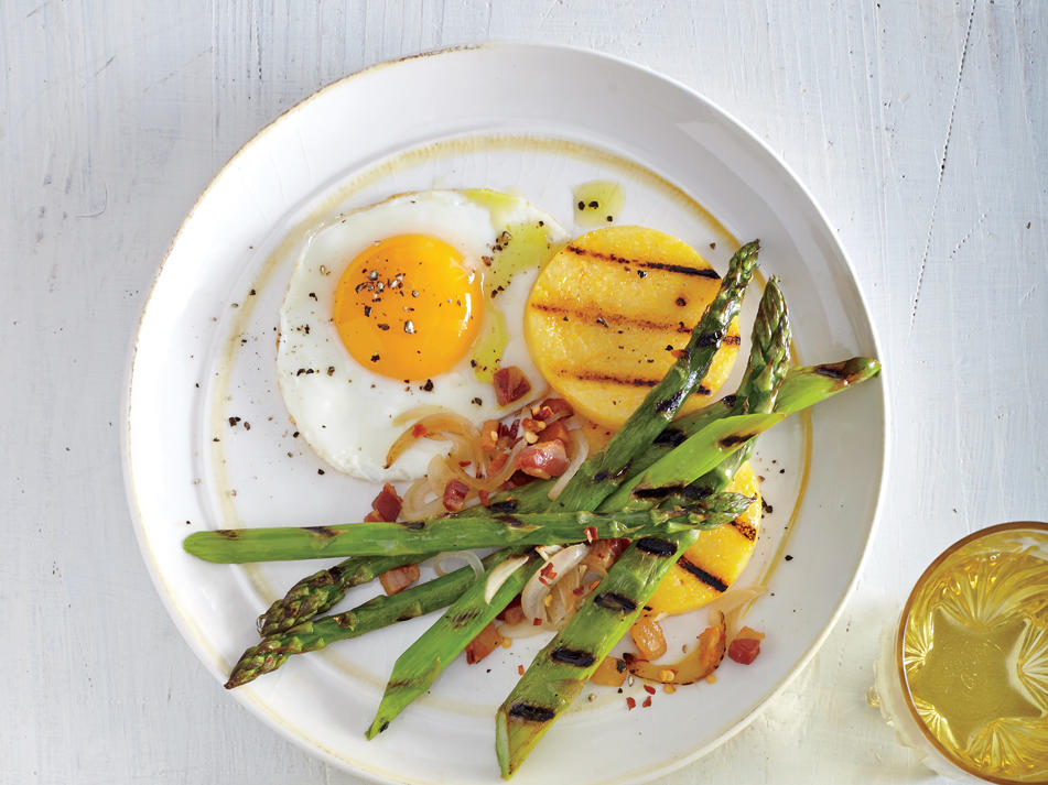 Asparagus and fried eggs are a classic springtime combo for good reason—they're delicious together. Medium-thick asparagus spears will char nicely outside while staying crisp-tender within.