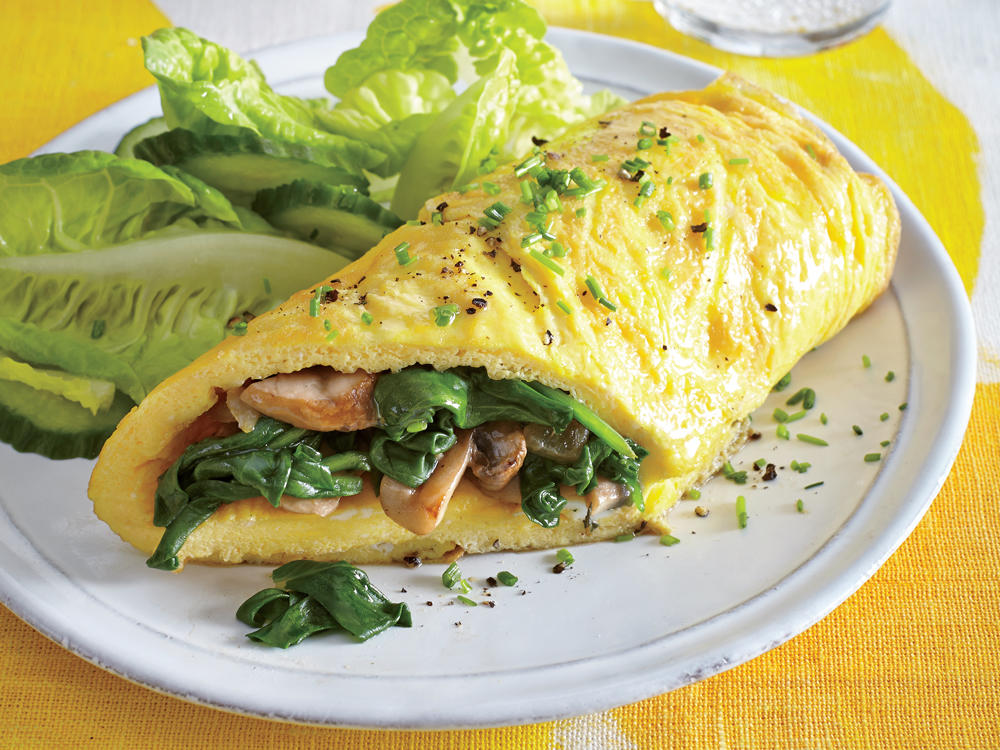 A veggie-stuffed omelet makes for one easy, satisfying dinner when paired with a simple side salad. While the cooked spinach mixture sits, it may give off some more liquid; strain this off to keep the omelet from becoming watery.