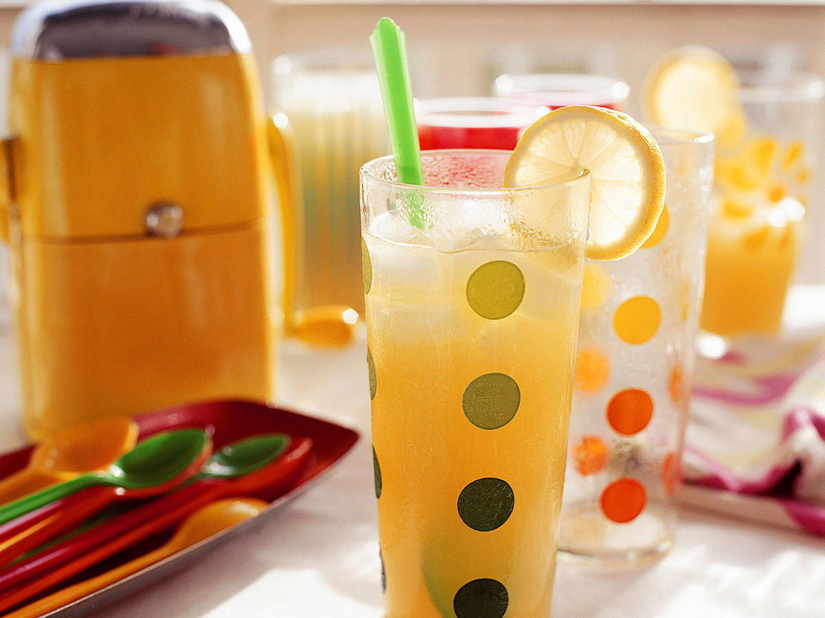 Freeze this fruity drink for at least four hours before serving at your next pool-side party. Golden or dark rum adds a rich flavor to the sweet cocktail. If you'd prefer a non-alcoholic version, substitute orange juice for the rum.
