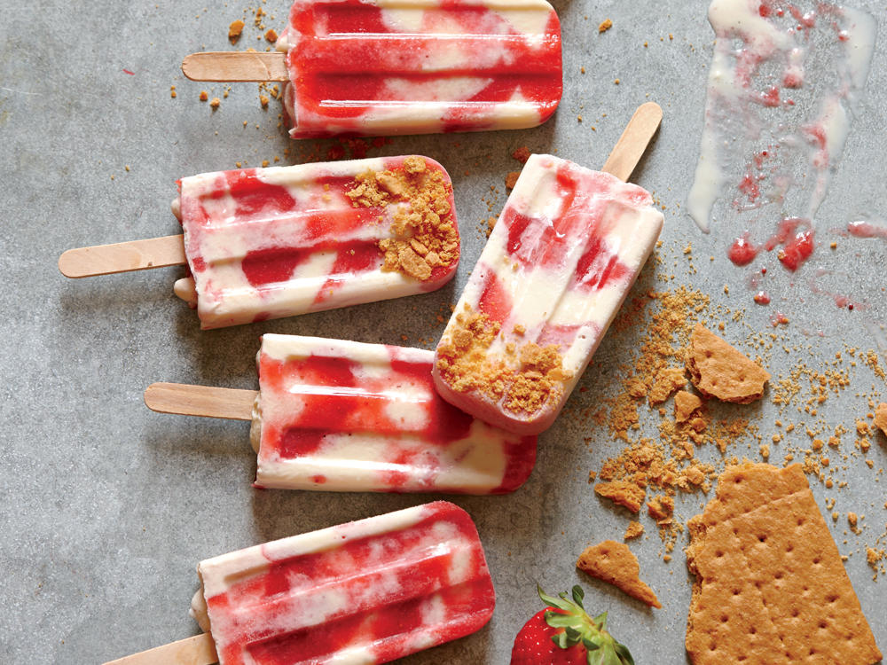Inspired by Philly, the land of cream cheese, comes this frosty, summery twist on cheesecake made with fresh strawberries and a Greek yogurt-cream cheese mixture, then dipped in graham cracker crumbs to finish.