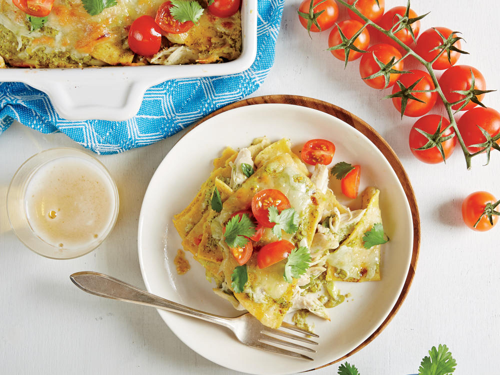 These enchiladas are a cinch to assemble and easy to freeze—just cover one of the pans with foil. If you plan to serve a crowd, bake in one (13 × 9-inch) baking dish. The chicken stays moist throughout baking and reheating, thanks to a gentle poach and a creamy verde sauce. Fresh cilantro stems have tons of favor; make sure to include them in the sauce.