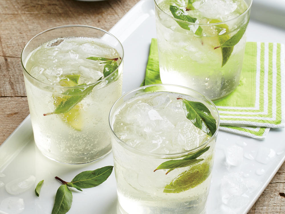 Paired with peppery ginger, the anise flavor of Thai basil gives you a highly refreshing summer sipper. Look for kaffir lime leaves at Asian markets. If kaffir leaves are unavailable, simply omit. This recipe will also work nicely with fresh mint or cilantro sprigs instead of Thai basil.