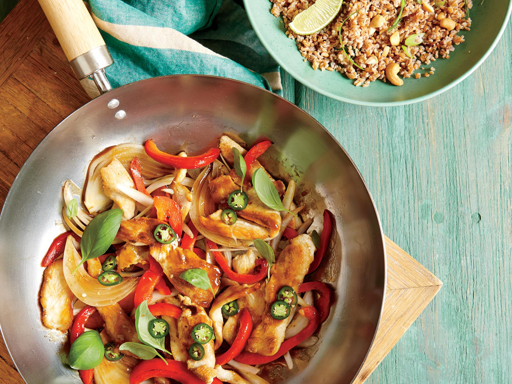 Red bell peppers are the star vegetable in this stir-fry, a crisp, sweet counterpoint to the serrano chile heat. Use any vegetables you like, but keep it simple; one or two vegetables, plus the basil and chicken, are all you need.