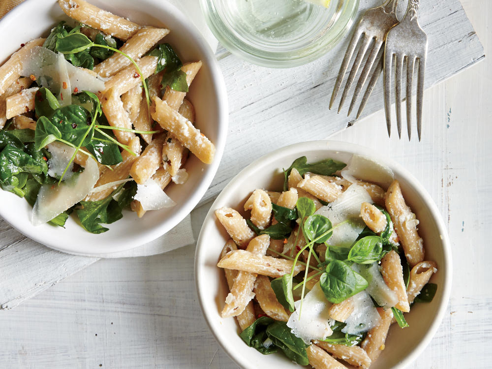 This saucy vegetarian pasta takes on a subtle peppery bite from the arugula and watercress, so feel free to leave out the red pepper if feeding heat-sensitive palates.