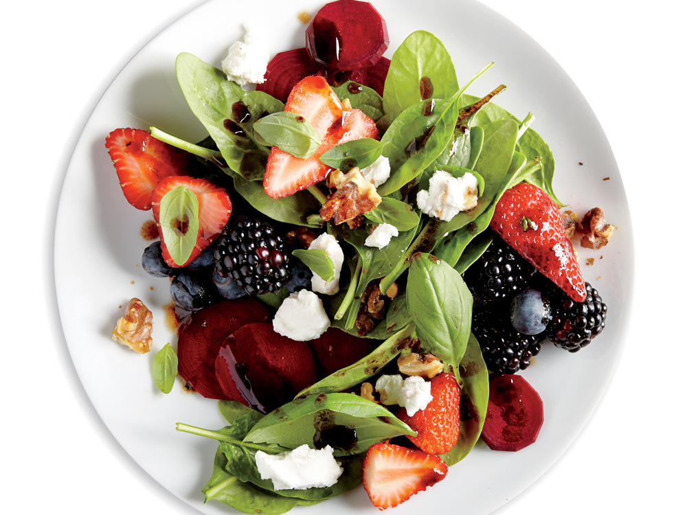 In this vibrant salad, the sweet flavors of blueberries, blackberries, and strawberries alike complement the salty tang of raw beets and goat cheese. Tossed in a balsamic rosemary vinaigrette, this no-cook salad will quickly become one of your all-time favorites.