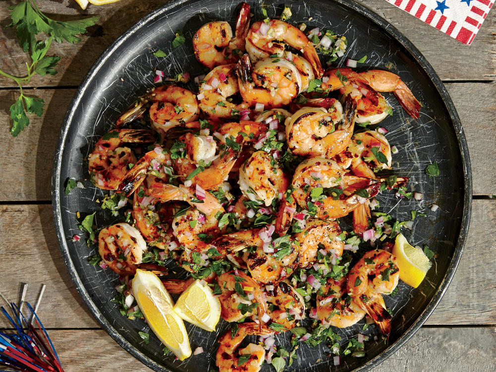 Our finishing touches—a hit of herbs, peppery olive oil, and tangy vinegar—make these shrimp the freshest, most irresistible appetizer. Leave the tails on so guests have a handle for these tasty bites.