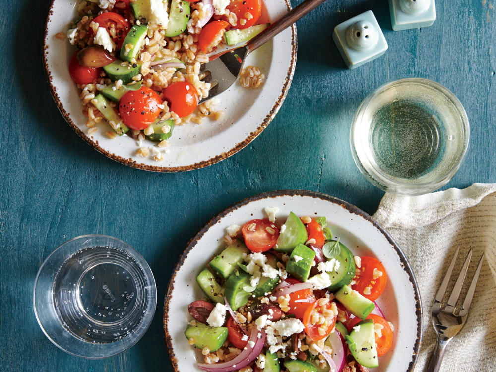 Whole-grain farro bulks up this hearty Mediterranean salad. If you like the crunch of fresh red onion but not the full pungency, give the slices a 30-second dip in ice water to tame the flavor; drain and toss in the salad.