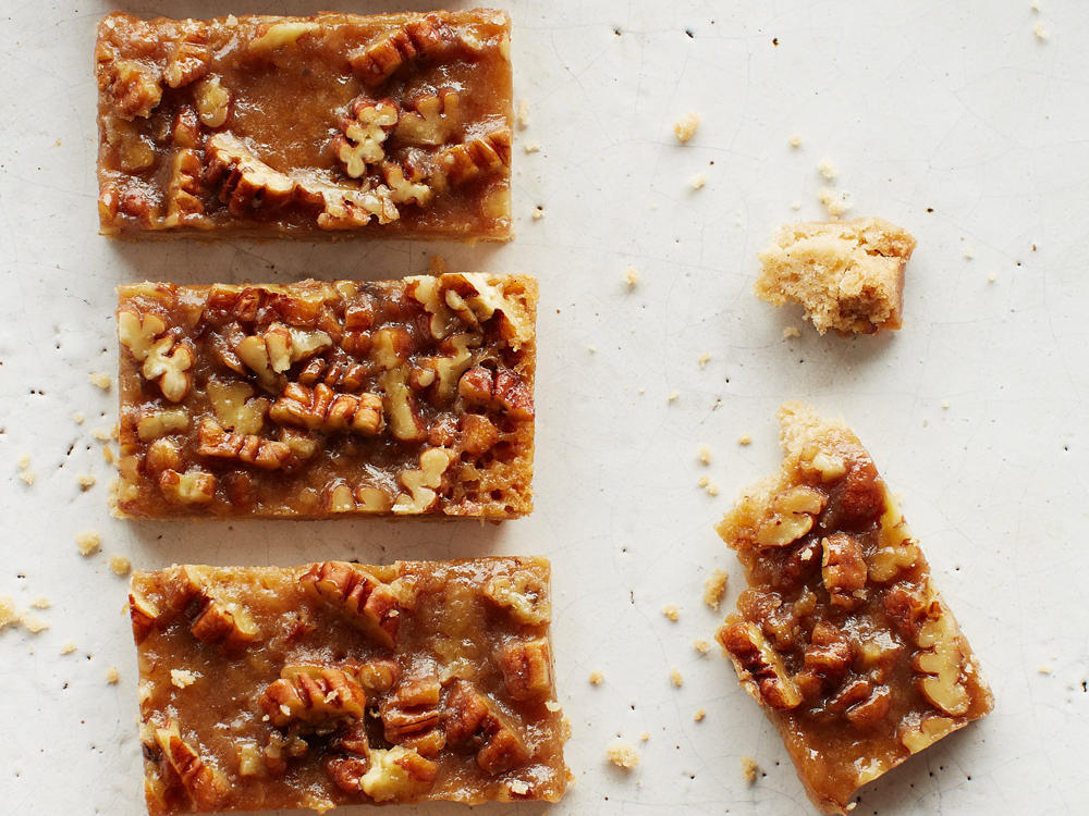 Reminiscent of pecan pie, gluten-free Maple-Pecan Bars deserve a spot at your dessert buffet. Use pure maple syrup to form the gooey brown sugar and pecan mixture needed to make these heavenly bars.