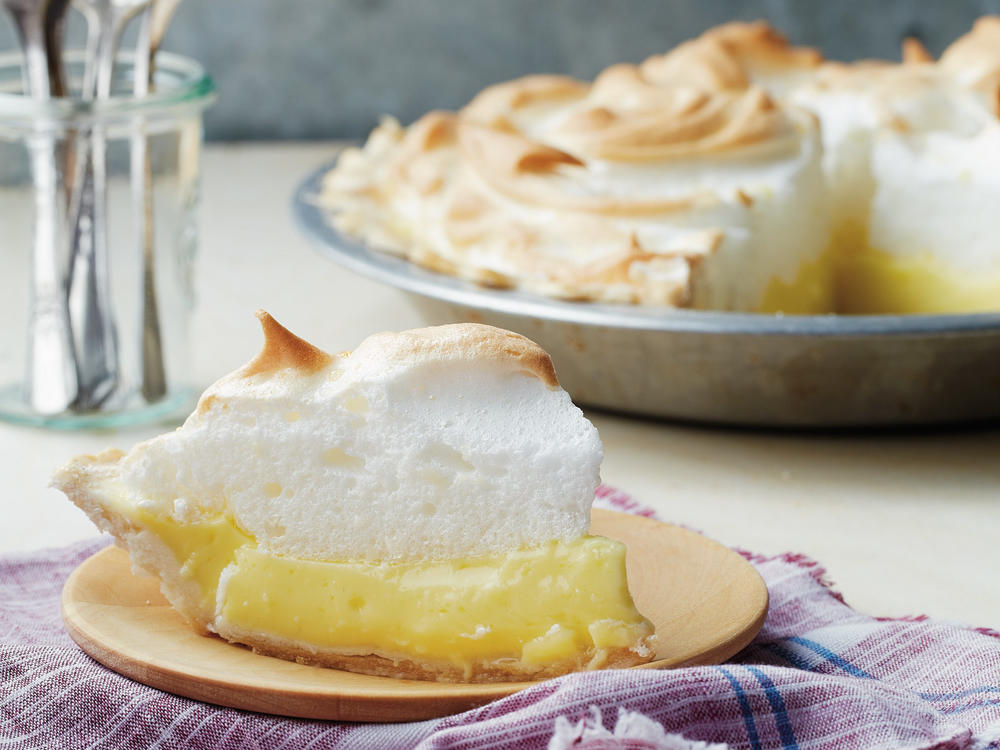 A gluten-free crust serves as the base for tangy-sweet lemon custard and a fluffy meringue topping in this fresh spin on the classic.