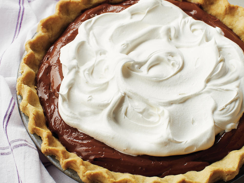 This pie's luscious, chocolaty filling is sure to win you some brownie points with anyone who's lucky enough to get a slice. Pressing the chocolate mixture through a fine mesh sieve removes any lumps of cornstarch and egg and creates a smooth, creamy filling.