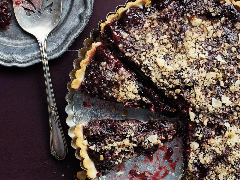 Use fresh or frozen cherries to make the deep red-hued, sweet-tart filling for this gluten-free tart. The crunchy, crumbly almond streusel really sends it over the top.