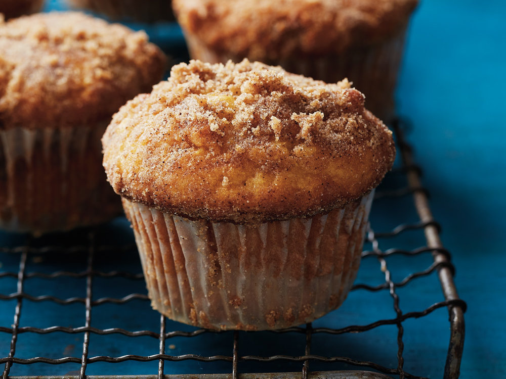 These sweet muffins are an ideal dessert or an indulgent breakfast. Whichever you choose, you'll love them for their nutty flavor and sugary topping.