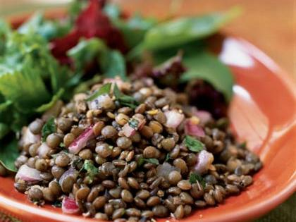 "Lentils are popular across Italy, where they are grown in Umbria in the north and Puglia and Sicily in the south. Technically not a ""bean,"" lentils are legumes. Unlike beans, lentils require no soaking, so this salad is quick and easy to prepare. Serve as a side salad, or add a cup of diced mozzarella, and it makes a light main dish."