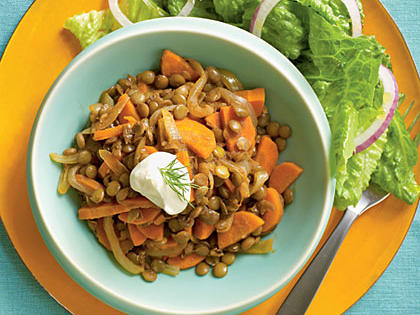 Slightly sweet and spicy, ground Aleppo pepper brightens the sauce, while carrots and yogurt lighten earthy lentils. Serve with a simple romaine salad for a weeknight dinner.