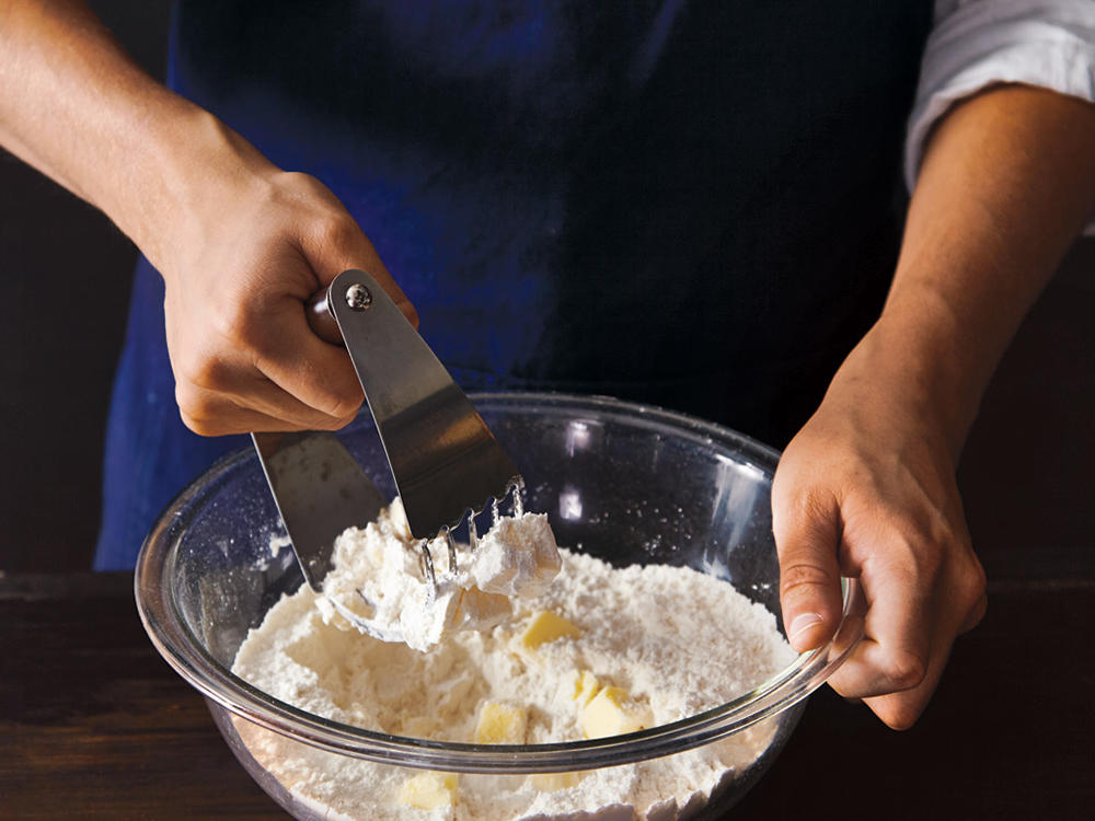 Mix dry ingredients with butter.