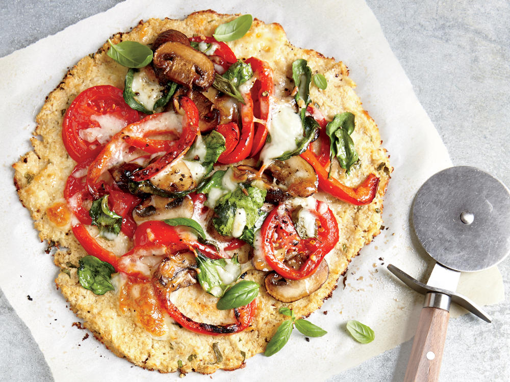 "No ""knead"" for bread—this cheesy veggie crust has half the carbs and double the fiber of traditional pizza dough."
