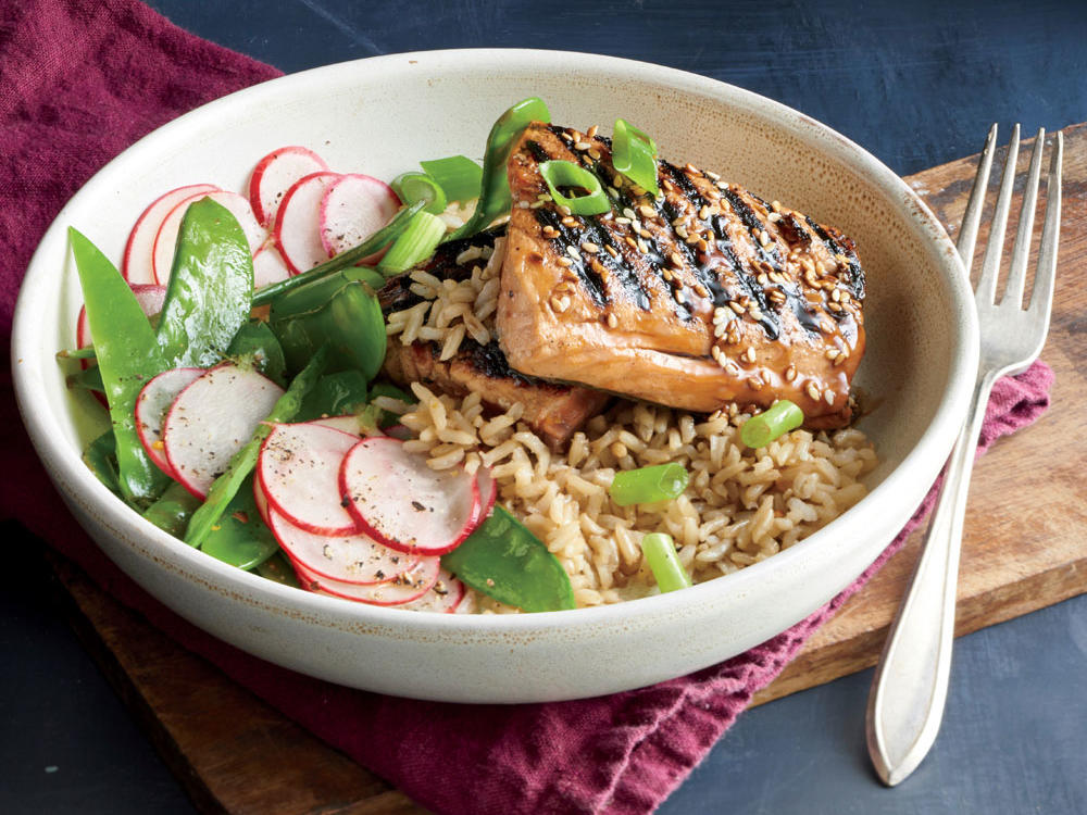 A soy sauce, honey, and vinegar mixture doubles as a marinade for the salmon and a drizzle over the finished dish.
