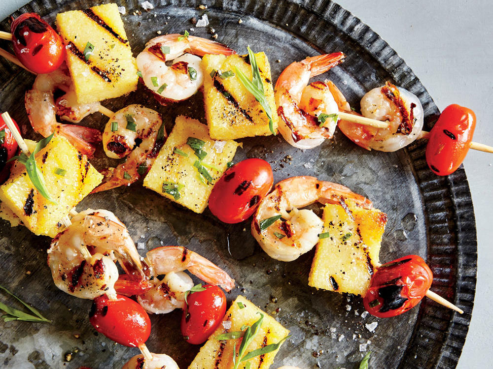 In this recipe, the remaining refrigerated polenta is cut into cubes and threaded onto skewers alongside shrimp and grape tomatoes. This filling dinner comes together quickly and satisfies with less than 300 calories per serving.