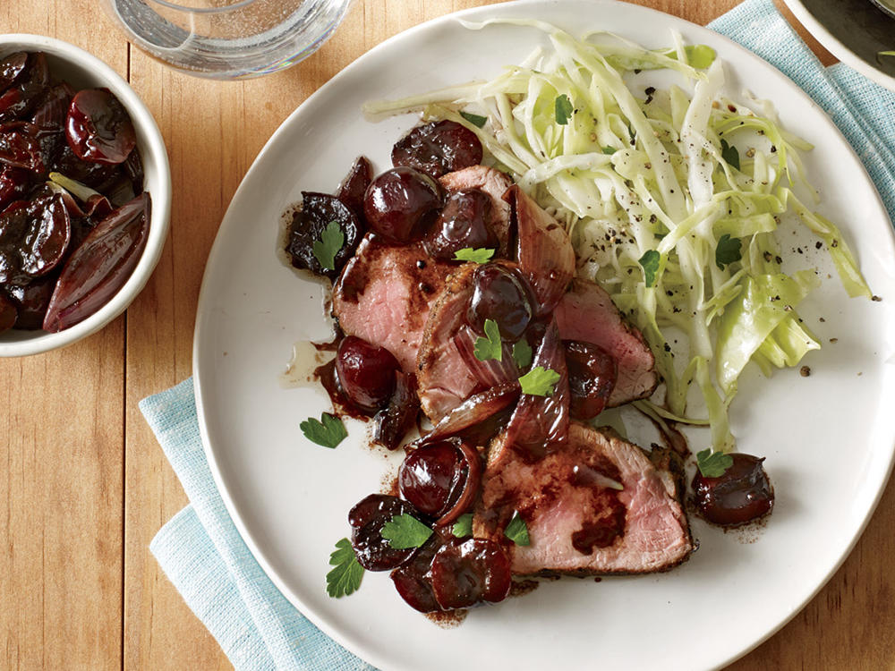 Easy enough for a busy weeknight and elegant enough for guests—that's the beauty of this recipe that pairs sweet cherries with roasted pork tenderloin. When fresh cherries are out of season, you can use frozen (you may need to cook the sauce a little longer because frozen cherries tend to release more liquid). The fruity sauce gains incredible richness from a small amount of butter; be sure to stir the butter in at the end to keep its flavor more forward. If you don't have shallots on hand, you can substitute a sliced small yellow onion.