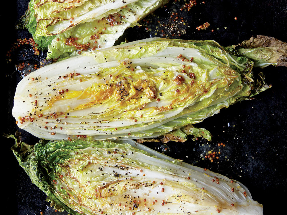 Caramelizing cabbage under the broiler draws out its natural sugars and deepens the flavor of the glaze. Preheat the roasting pan to jump-start the browning process.