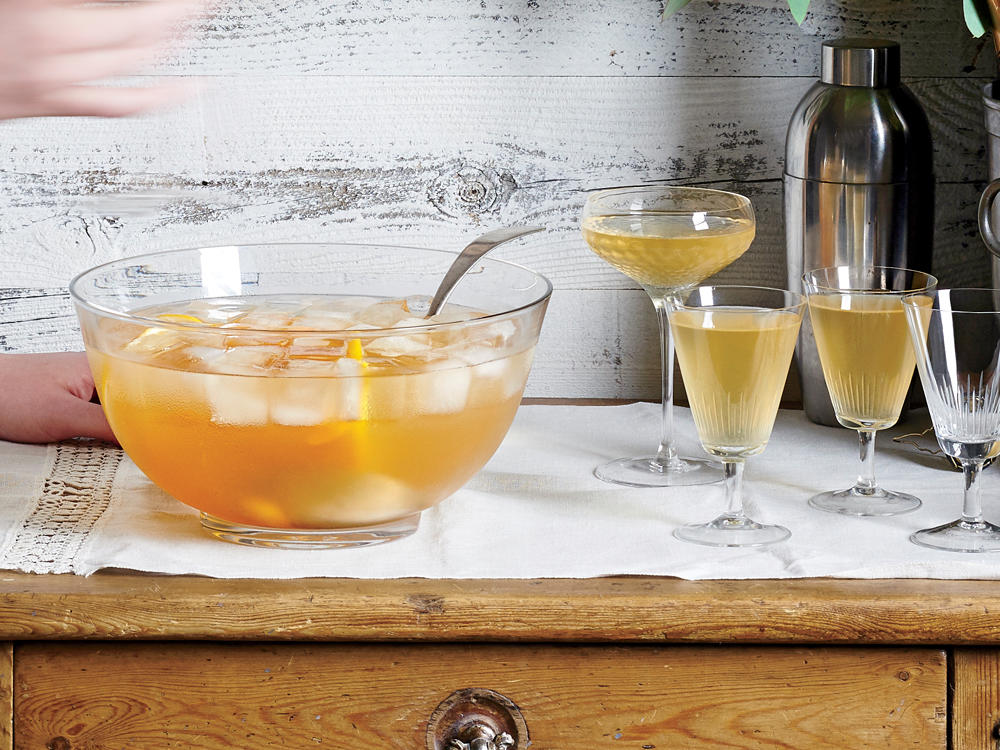 """In the following collection, we share 479 years of our staff's collective holiday knowledge and know-how for everything from the perfect centerpiece turkey to the best apple pie.                                                              First up is a cocktail from the former Editor of Cooking Light, Scott Mowbray.""""I wanted the Spanish flavors of Catalonian cava and Jerez sherry to mingle in a holiday punch. The syrup, called an oleo saccharum, pulls essential oils from the orange peel and perfumes the cocktail,"""" Scott explains.                                                              Make this punch up to 4 hours ahead, but wait to add the cava until just before serving."""