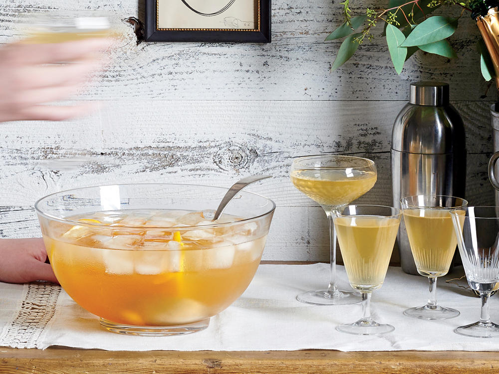 Simplify the liquor shopping list: Skip setting up a full bar and instead offer a signature cocktail featuring just one or two types of spirits or wine. Make this punch up to 4 hours ahead, but wait to add the cava until just before serving.