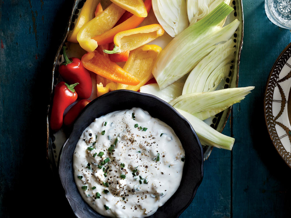 While you're putting the final touches on your dishes, your guests can snack on this dip. Precut crudités will hold up well if you'd like to prep them the day before. Wrap trimmed and cut veggies in a damp paper towel and refrigerate in a zip-top plastic bag for the crispiest texture.