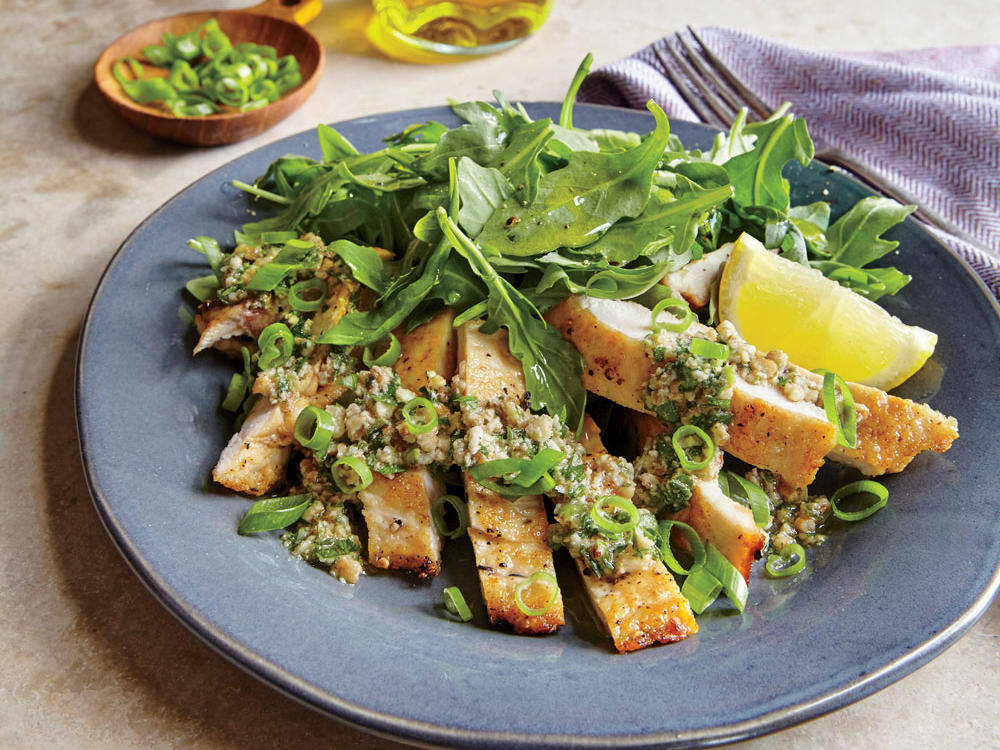The lemony, nutty gremolata is addictive. Dollop it over any number of proteins, or spread it on a toasty sandwich. Serve the chicken with a peppery arugula salad, and you're good to go.