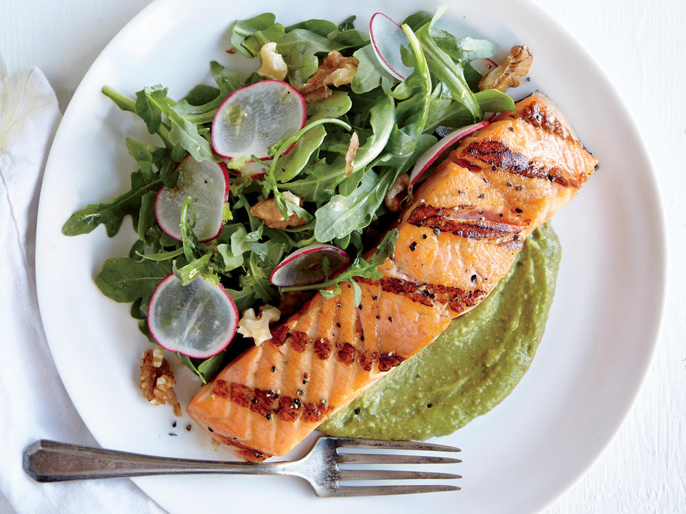 Salmon is a staple in paleo diets as it's incredibly rich in healthy fats. The dish contains 32 grams of total fat: That's the amount in three Butterfinger candy bars. But the quality of the food—salmon, walnuts, avocado, olive oil—is premium, fresh, and delicious. You'll walk away happy, satisfied, and comfortably full—a fullness that will last for hours. Bonus: It's fast food, ready in less than 20 minutes.