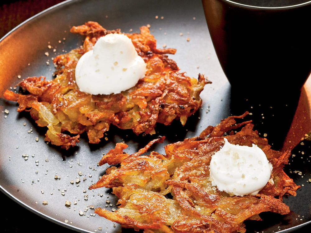 These sweet-savory pancakes get irresistibly crisp from pan-frying. Keep cooked latkes warm in a 200° oven as you prepare the next batch. Serve with a dollop of fat-free sour cream if you want a tangy adornment.