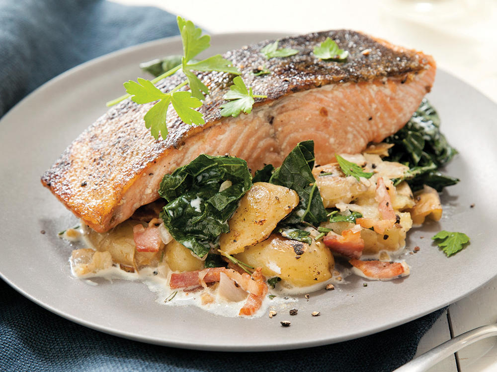 Since falling in love with very smoky Tennessee bacon (Benton's), I've moved to using it as a flavor agent; I almost never eat it on its own. Any very smoky bacon will do. This is a hearty winter dish, layering potatoes with kale and crisp-skinned roasted salmon.