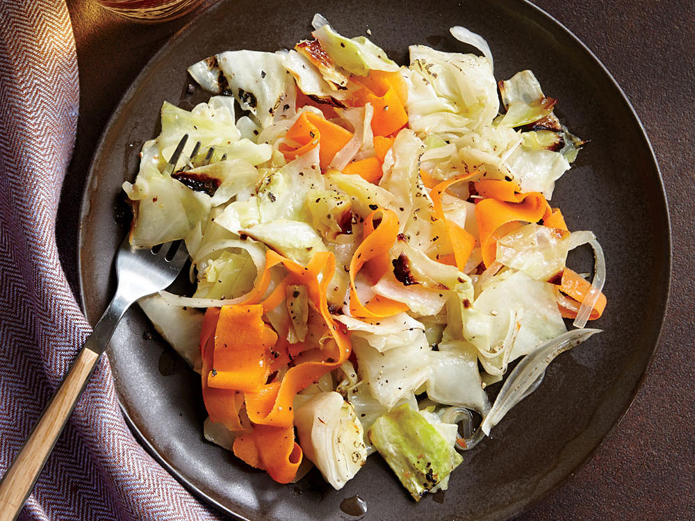 Nicely roasted cabbage turns sweet and earthy, with a deliciously silky texture. There's a beautiful balance of flavors here—sweetness from cabbage and carrots, fire from hot sauce, brightness from vinegar, and richness from butter.