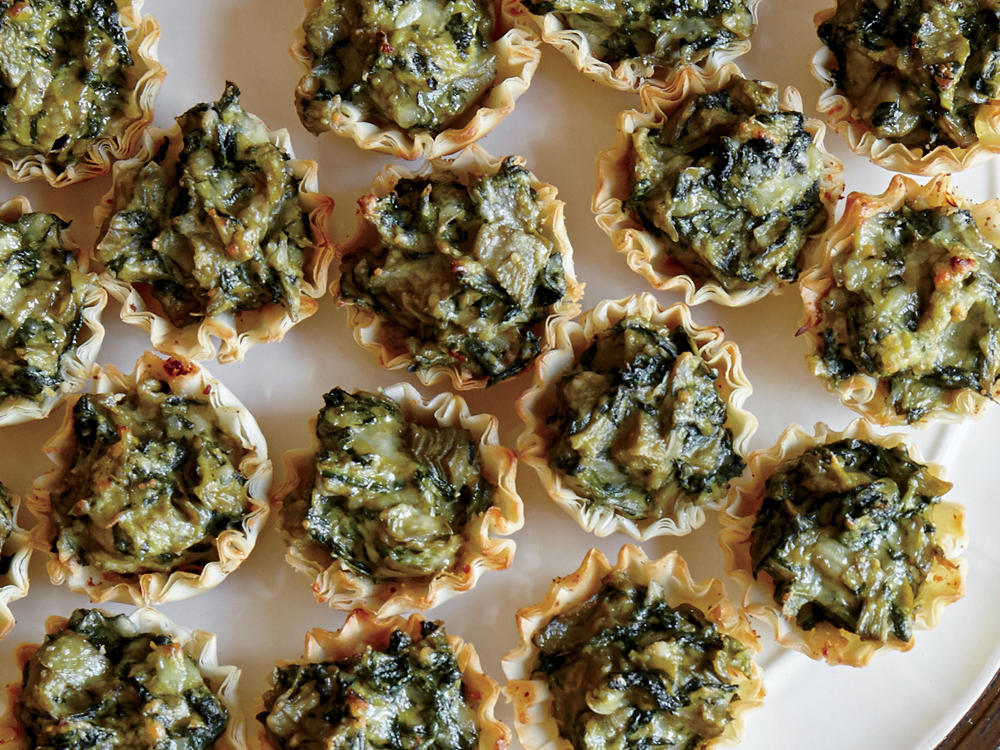 Save 167 calories, 3.6g sat fat, and 393mg sodium per serving over traditional spinach-artichoke dip. Frozen artichoke hearts contain no added salt, unlike the canned variety, which may contain more than 300mg per half cup.