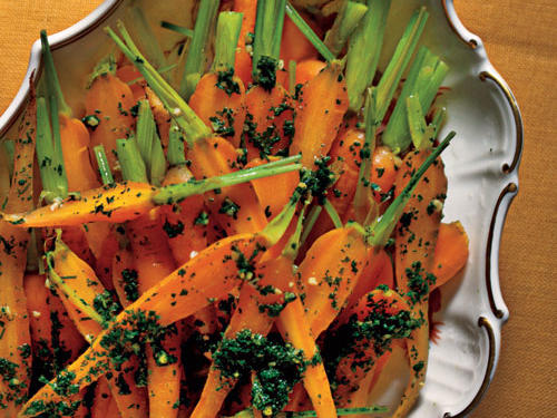 The vivid garlic-and-herb vinaigrette contrasts with the sweet carrots.