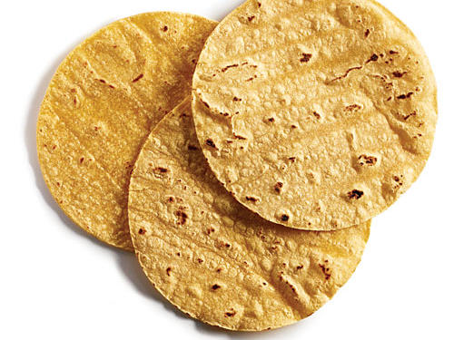 Tired of toast? We hear you. Why not try a slimming 6-inch corn tortilla instead. They're ideal if you're on a gluten-free diet. Each tortilla boasts a skinny 55 calories, nearly 2 grams of fiber, and only 5 milligrams of sodium per tortilla. Load yours with eggs and salsa, roll it with sliced avocado and reduced-fat Cheddar, spread it with your favorite nut butter for a quick grab-and-go meal. If you have time, prepare Egg and Cheese Breakfast Tacos with Homemade Salsa for a weekend brunch.