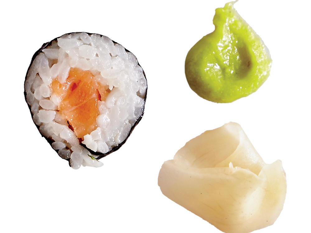 Salmon Sushi Roll Pieces with Pickled Ginger and Wasabi