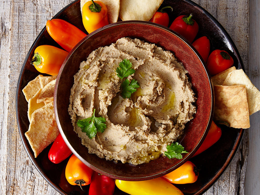 This homemade hummus is a great appetizer for holiday parties and casual dinner get-togethers alike. Healthy dippers include baby carrots, bell peppers, pita chips, radishes, jicama, and sugar snap peas.