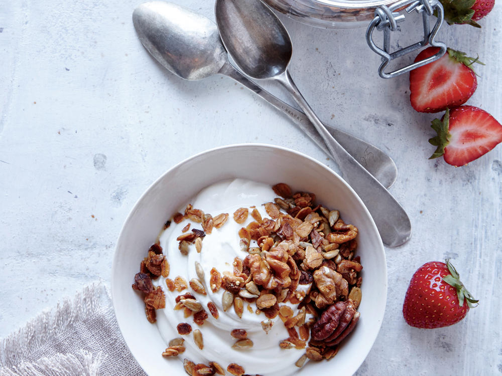 Meet your new granola, which has two-thirds less sugar than most store-bought varieties. We like it with a little extra kick, but knock the red pepper back for less heat. Stir into yogurt, sprinkle over fresh fruit, or toss into salads.