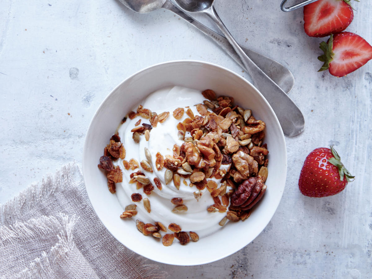 Who says desserts have to be heavy and sugar-laden? Meet your new granola, which has two-thirds less sugar than most store-bought varieties. Pecans, walnuts, sunflower seeds, and quinoa lend 4g of protein, while honey and ground cinnamon add a touch of sweetness. We like it with a little extra kick, but knock the red pepper back for less heat. Stir into yogurt or sprinkle over fresh fruit for an unexpected—and unexpectedly delicious—end to the big feast.