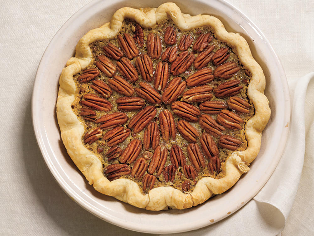 Using refrigerated pie crust adds a little more fat to the bottom line, but we tweak the remaining ingredients so that a slice delivers less than half the fat and calories of traditional pecan pie.