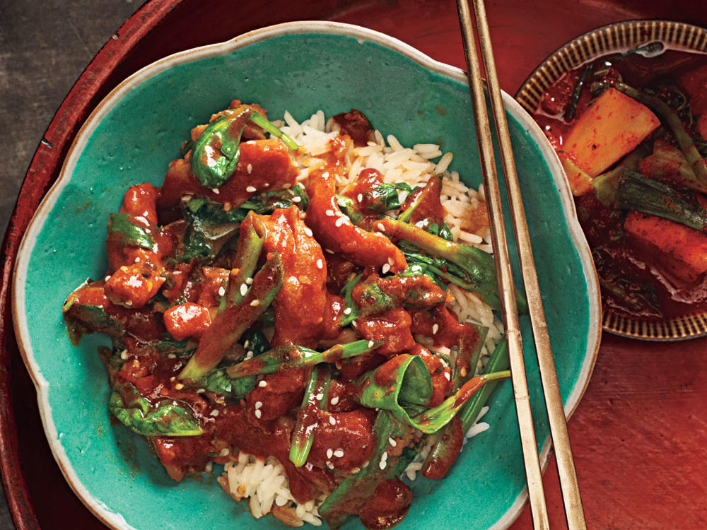 Dak bokkeum, adapted here, is often a one-pot Korean dish of chicken, carrot, onion, and potato, all stewed in a spicy-sweet sauce. But you can adapt it to a mix of your favorite veggies. Our version features spinach and flavorful chicken thighs.