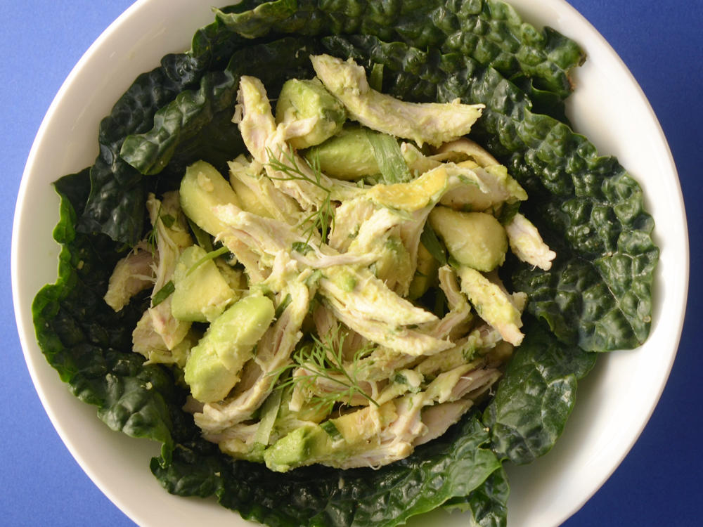 By foregoing the mayonnaise for an equally creamy avocado, you're saving on sodium and sat fat while adding healthy unsaturated fats to your diet. Use a sturdy type of greens for the salad, like lacinato kale, and it can easily stay fresh and non-soggy in your lunchbox.