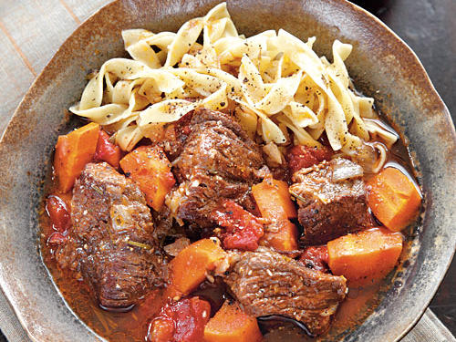 This classic French braised beef, red wine, and vegetable stew is simple and delicious. The flavor and texture allow you to keep it warm for your guests. Buy a whole-grain baguette, bagged salad greens, and bottled vinaigrette to round out the meal.