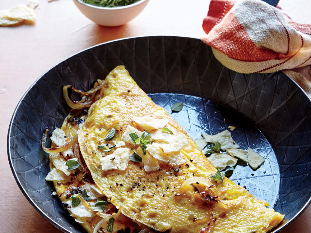 Say hello to next-level breakfast for dinner. Inspired by a traditional crispy, potato-studded Spanish tortilla, our quick-fix fluffy omelet is topped with potato chips for a touch of crunch.