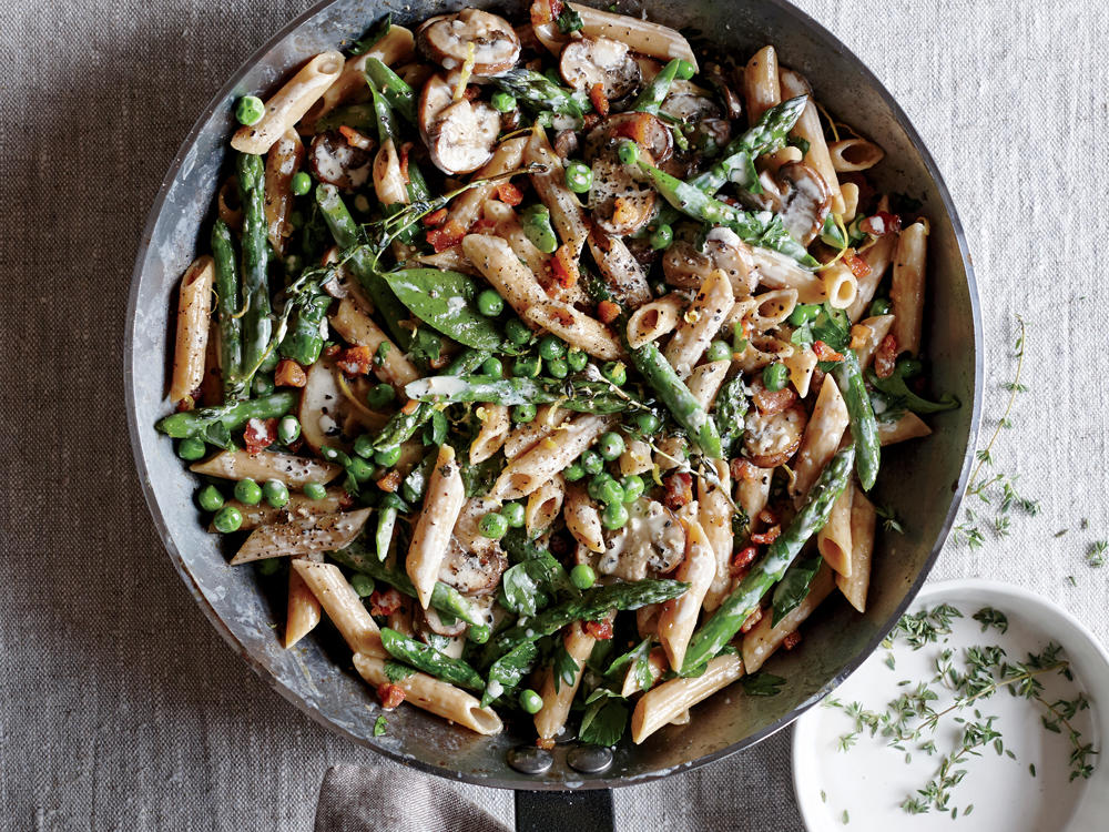 Fresh spears of asparagus, pancetta, and cremini mushrooms are tossed in a light white sauce. Lemon rind adds a welcomed extra punch of flavor.