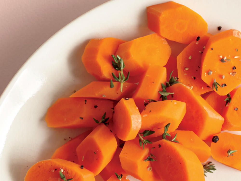 Cooked carrots are an often overlooked choice for a vegetable side. A little lemon, salt, pepper, and thyme are all you need for this nutritious dish.